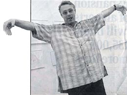 recent tabloid snaps of Hirst in his newly adopted Messiah-like pose -- arms raised in a crucifix position